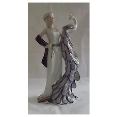 Lady Holding A Peacock Figurine From KPM