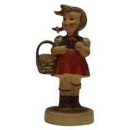"Hummel Figurine Titled ""Little Shopper"""