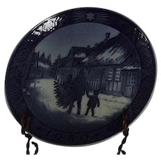 """Royal Copenhagen Annual Christmas Plate Titled """"Bringing Home The Christmas Tree"""""""