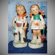 Tall Pair of Boy and Girl Figurines
