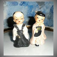 Pair of Chinese Boy and Girl Salt and Pepper Shakers