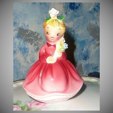 Young Girl in Pink with Flowers Figurine