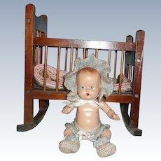 Adorable Vintage Composition Baby in  Rocking Crib