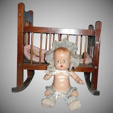 Adorable Vintage Composition Baby in  Rocking Crib