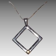 Beautiful Sterling Silver and 18 kt Yellow Gold Accent Square Pendant On Sterling chain