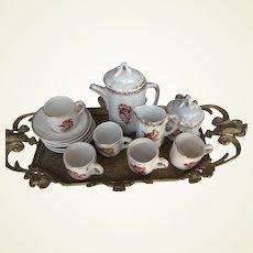 Fine porcelain coffee set on brass tray