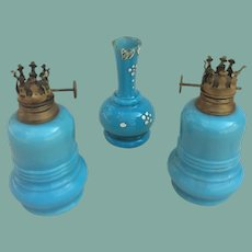 Blue glass oil lamps and vase