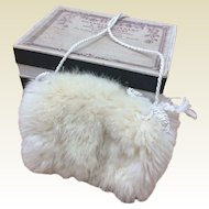 Charming fur muff in box