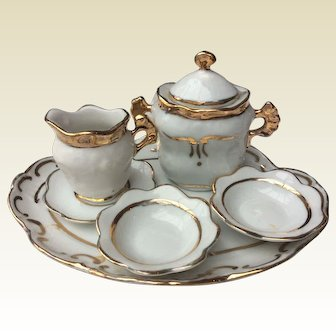 Charming set of dishes for doll display