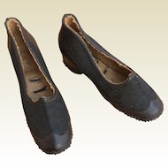 Small black rubber galoshes for French Fashion