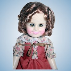 """Shirley Temple vinyl doll 11"""" tall from Ideal, 1983, boxed. Suzanna of the Mounties outfit."""