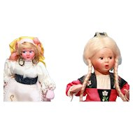 "Two celluloid head dolls dressed in ethnic costume 9"" and 6-1/2"" tall, good condition, , untagged"