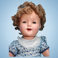 "Shirley Temple composition  doll by Ideal 18"" markings of 'Ideal Cop N&T Co with bias tape early wig"
