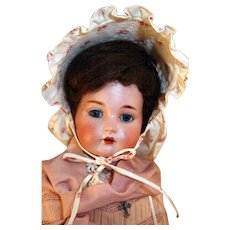 """Germany Antique bisque doll by K & R Kammer and Reinhardt that is 22"""" tall."""