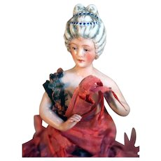 Beautiful half doll with arms away from body with Colonial hairstyle.