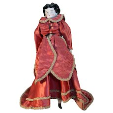 """Antique German china head doll with 1890s hairstyle 17"""" long and 8-1/2"""" head circumference"""