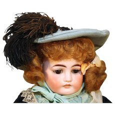 """Antique German bisque head doll by Ernst Heubach 18"""" tall from 1888-1911 with antique dress."""