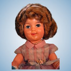 """Shirley Temple vinyl doll 17"""" tall by Ideal from 1950's with original tagged outfit."""
