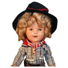 """Shirley Temple 13"""" tall composition doll dressed in the style of 'the Texas Ranger'"""