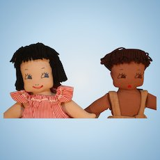 """Pair of cloth dolls with hand embroidered faces 15"""" tall in very good condition from circa 1940-1950's approximately."""