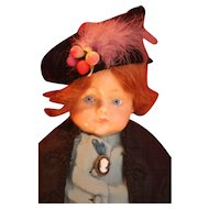 "Antique German wax over composition girl doll 22"" Circa 1910 with stationary blue glass eyes and a beautiful auburn red mohair wig."