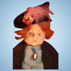 """Antique German wax over composition girl doll 22"""" Circa 1910 with stationary blue glass eyes and a beautiful auburn red mohair wig."""
