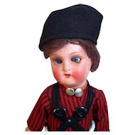 "Painted bisque vintage boy doll 9"" marked 251-17 10 with vintage clothing."