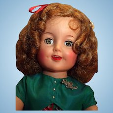 """Shirley Temple vinyl doll by Ideal 19"""" tall original tagged plaid dress Circa 1950's in good condition."""