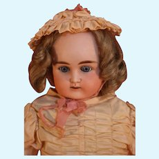 """Antique German bisque head shoulder plate doll by Alt, Beck & Gottschalck 22"""" tall from approximately 1885-1911 in good condition."""