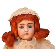 "Antique bisque head shoulder plate doll by Kestner in Germany that is 24"" long from 1892."