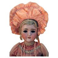 "Pansy III German bisque head antique doll 23"" tall, blonde with vintage peach dress."