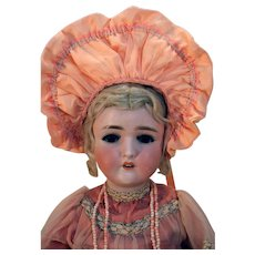 """Pansy III German bisque head antique doll 23"""" tall, blonde with vintage peach dress."""