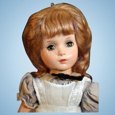 """Alice in Wonderland composition doll by Madame Alexander from 1947 14"""" tall."""