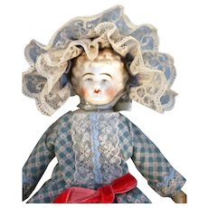 """Antique Stone Bisque Doll 9"""" Tall with Molded Blonde Hair Marked 114N."""