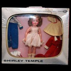 """Shirley Temple TV Wardrobe Package of 12"""" Shirley Temple in vinyl with  television set box with carrying handle and outfits, all original and marked.  Designed by Ideal. - Red Tag Sale Item"""