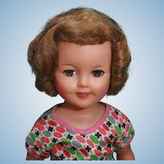 """Shirley Temple vinyl doll by Ideal is 17"""" tall and marked 'Ideal Doll ST-17-1' on head and Ideal Doll ST-17 on her back with replaced clothing from"""