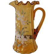 Hand blown Amber Pitcher with ruffled edge.