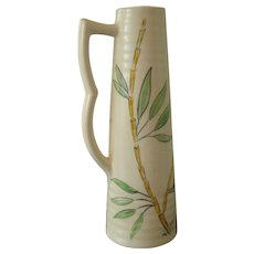 Vintage pottery pitcher with bamboo decoration