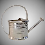 Your potted violets will be envious. CARTIER Sterling Watering Can/Vermouth Dispenser