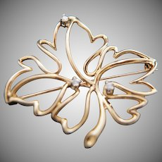Catching your first leaf – again. 14k Gold/Diamond Pin