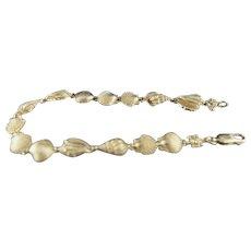 Better than beachcombing. 14k Seashell bracelet
