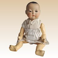 An Armand Marseille bisque headed 353 Oriental baby,