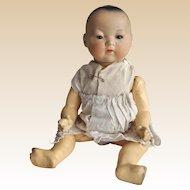 An Armand Marseille bisque headed 353 Oriental baby,