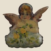 A beautiful antique tinplate Christmas cherub candle clip,