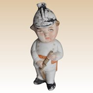 Unusual German bisque fireman squirter toy, 1910-20