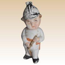 Unusual German bisque fireman squirter toy, 1910-20