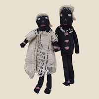A pair of circa 1900 primitive stockinette black dolls,