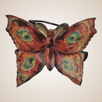 A German lithographed tinplate butterfly Christmas tree candle clip, circa 1910