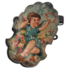 A German lithographed tinplate cherub Christmas tree candle clip, circa 1910