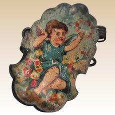 A German lithographed tinplate cherub Christmas tree candle clip, circa 1910